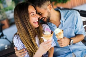 Couple laughing with ice cream
