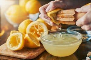 person squeezing lemon juice