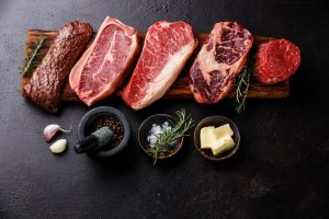 variety of steaks with spices