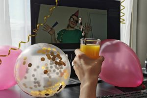 Woman dancing on screen for birthday party