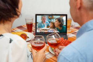 old couple cheersing on virtual birthday party call