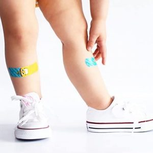 Baby with bandaids on legs