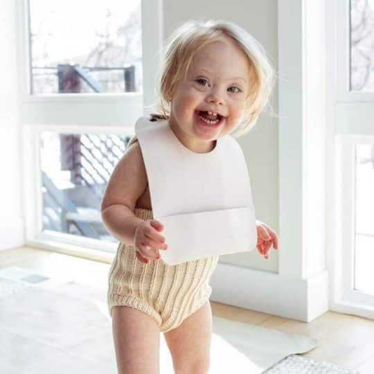 Toddler smiling with Gathre bib