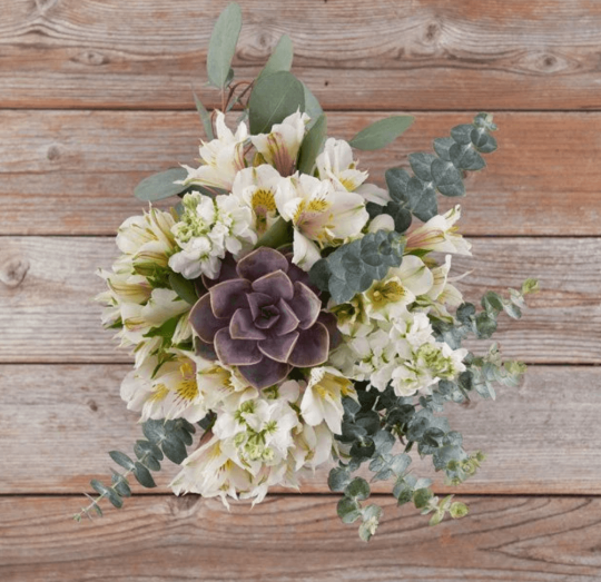 Bouquet with eucalyptus, white flowers and a succulent