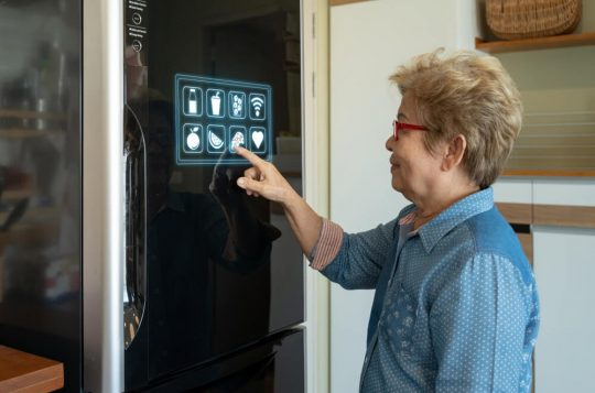 Woman touching the panel on a smart refrigerator