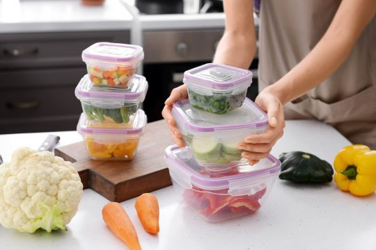 Tupperware filled with leftovers on the counter