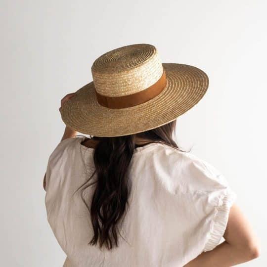 Woman in tan wicker hat