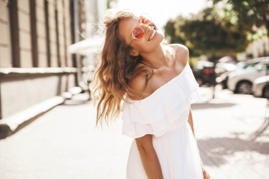 Woman in white off the shoulder dress