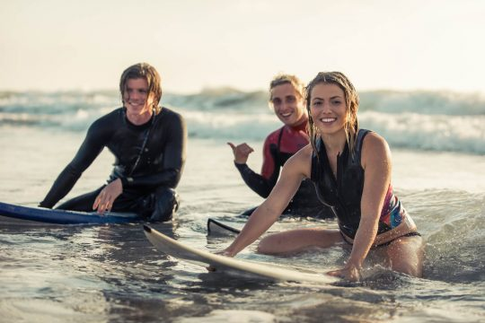 Surfing as an adult group of friends