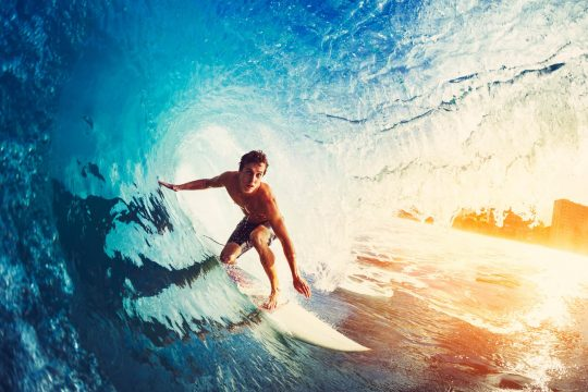 Adult man surfing a wave