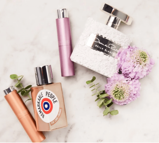 Scentbird tubes with designer perfumes nearby