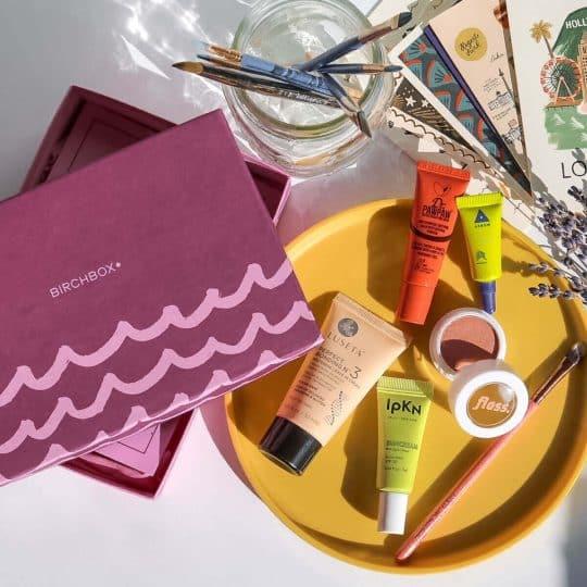 Birchbox next to painting supplies on a desk