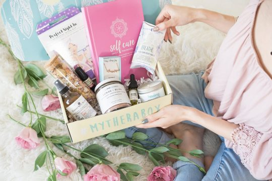Woman opening up a Therabox subscription box