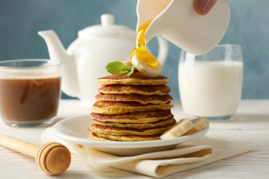 Stack of pancakes with golden syrup