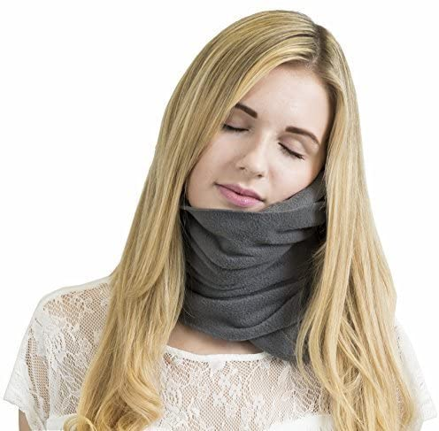 Woman sleeping with her turtle neck pillow
