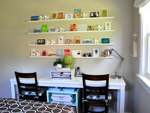 Postcards on display on a shelf