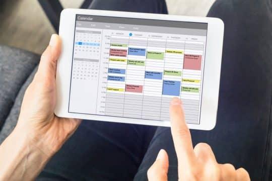 Somone looking at their calendar on their tablet