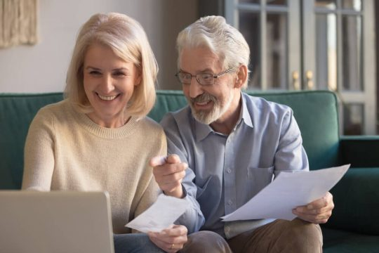Senior couple looking at different long term care policies