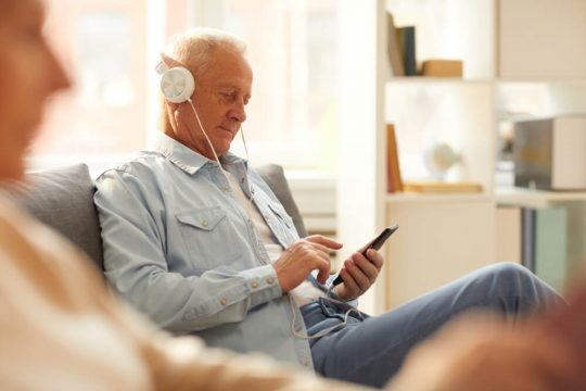 Man listening to a book with audiobooks.com