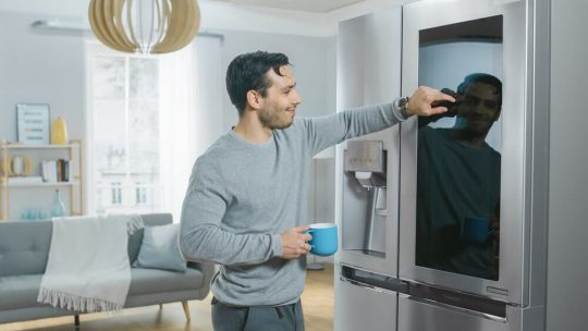 Man making a selection from his smart refrigerator