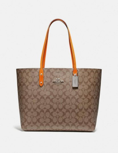 Brown Coach bag with orangge handles