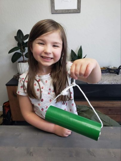 Girl holding up finished bee home