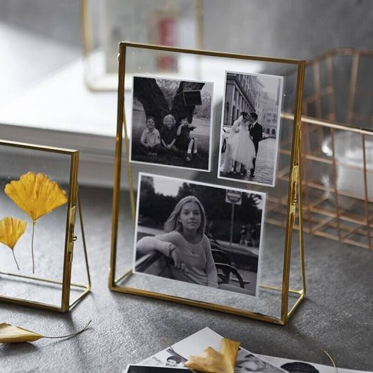 Clear, gold-rimmed picture frames