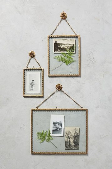 Gold scalloped-rim picture frame on a wall