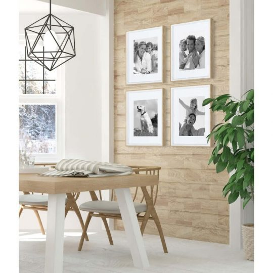 Neutral-colored dining room with cheap picture frames on the walls