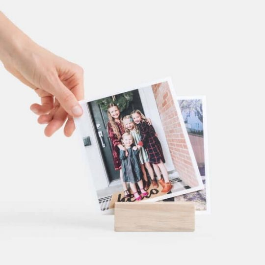 Woman putting a picture in a wood picture holder