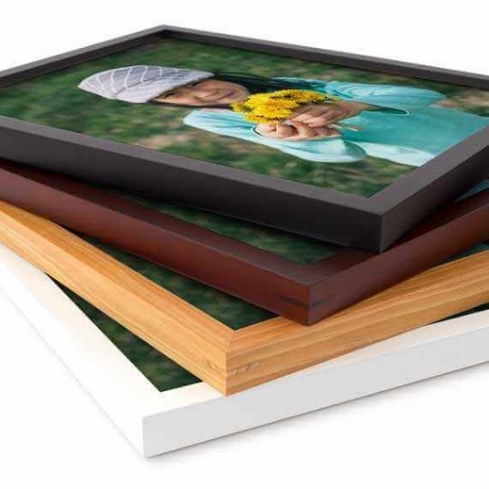 A stack of small picture frames in different colors