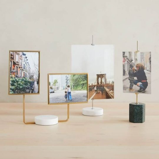 An array of picture holders on a desk