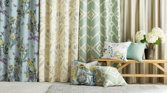 A b unch of curtains with pillows in front of the pillows