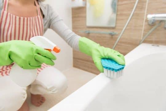 Woman scrubs the tub