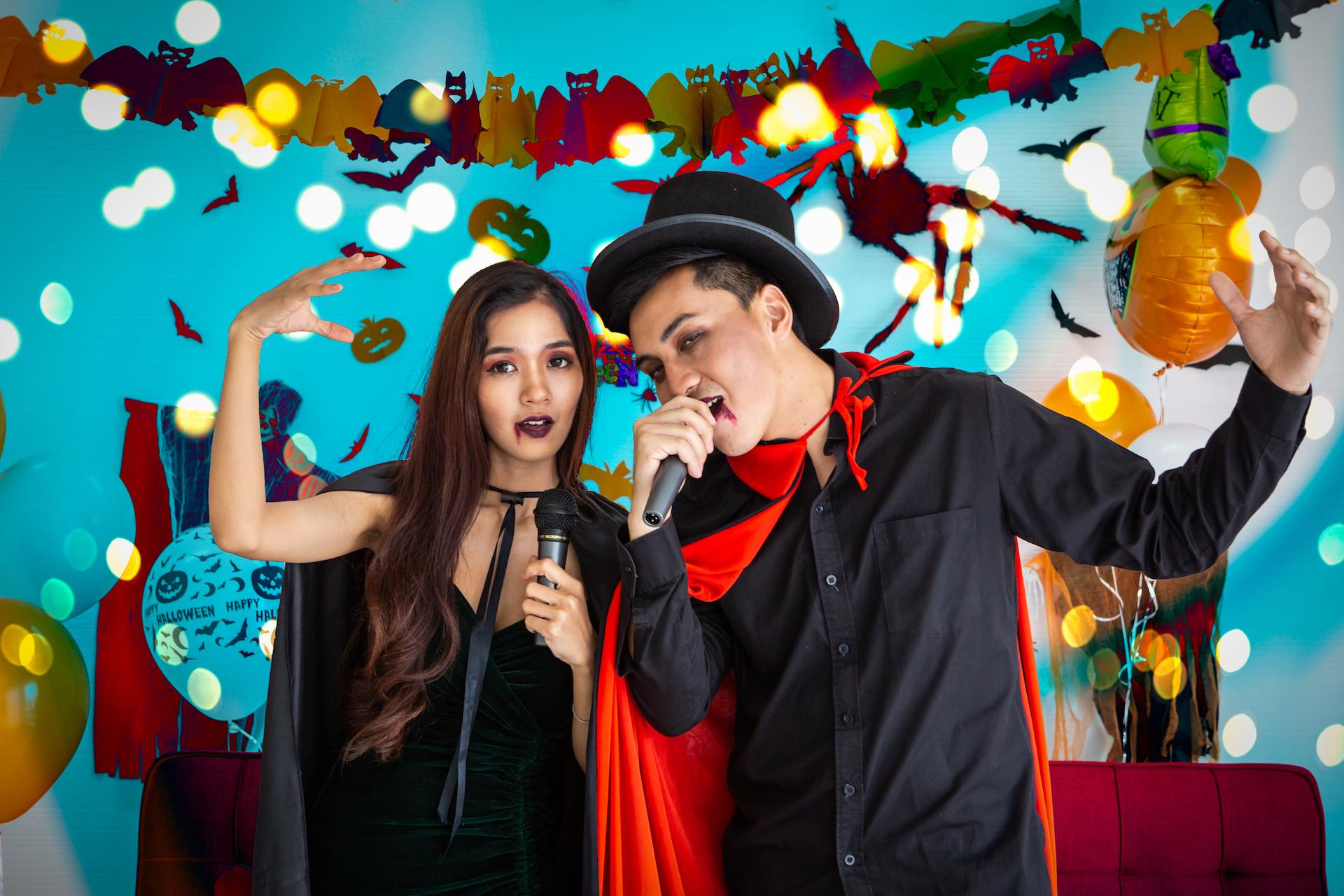 Two people dressed up in costumes singing karaoke