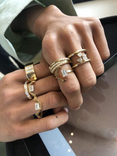 Someone wearing 7 Ame rings