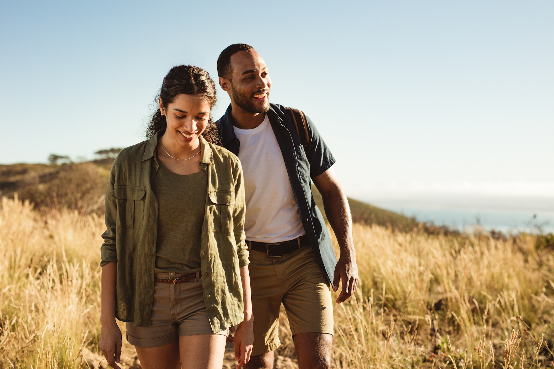 Man and woman hiking and smiling