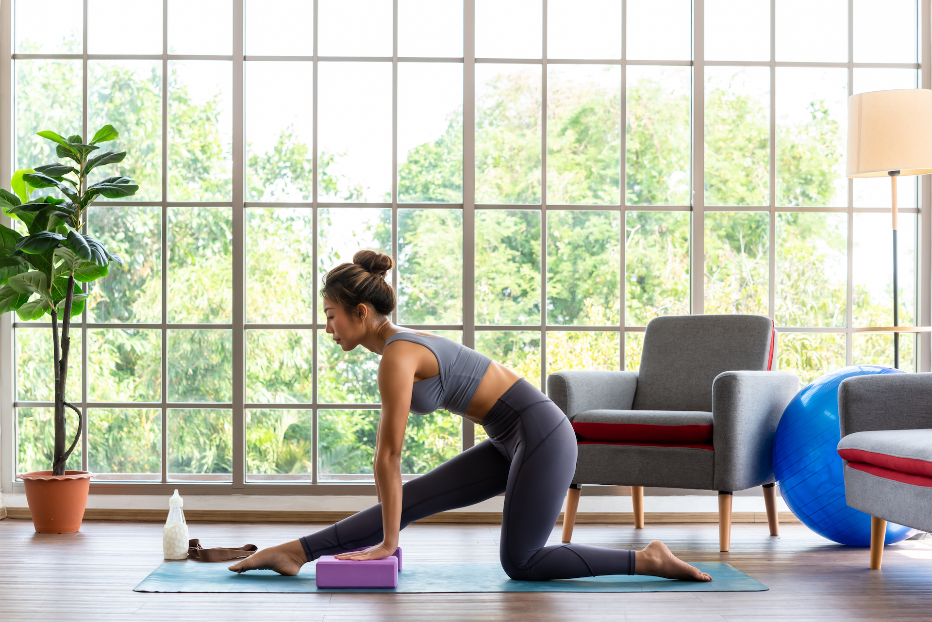 Woman exercising with Gaiam equipment