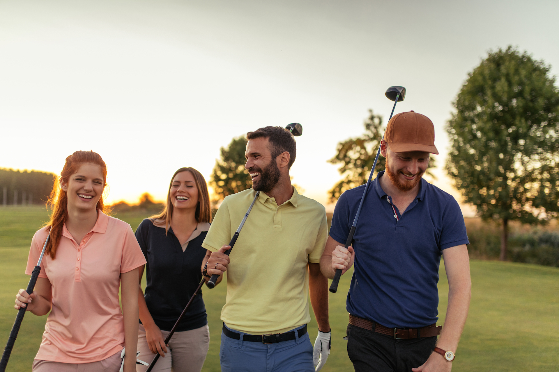 Friends walking through a golf course together