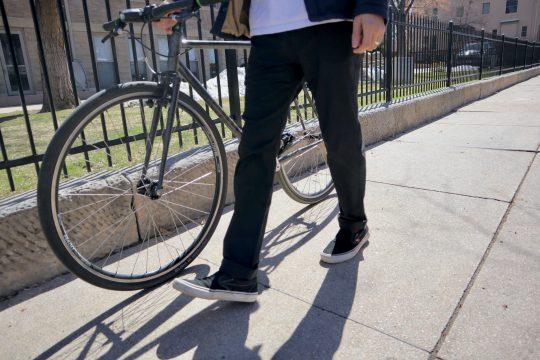 Man walking wearing Western Rise Evolution pants