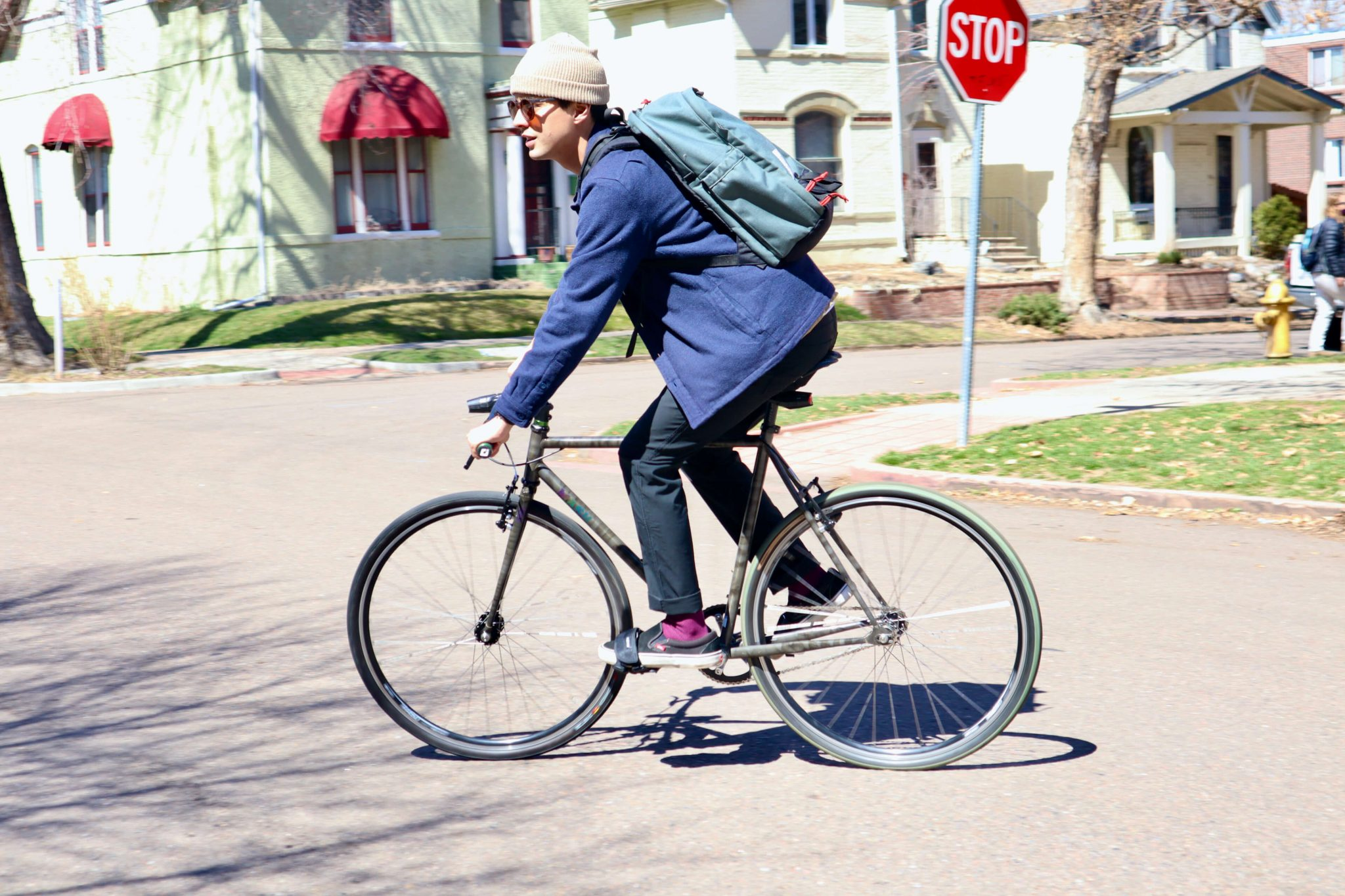 Man riding a bike while wearing the western rise evolution pants