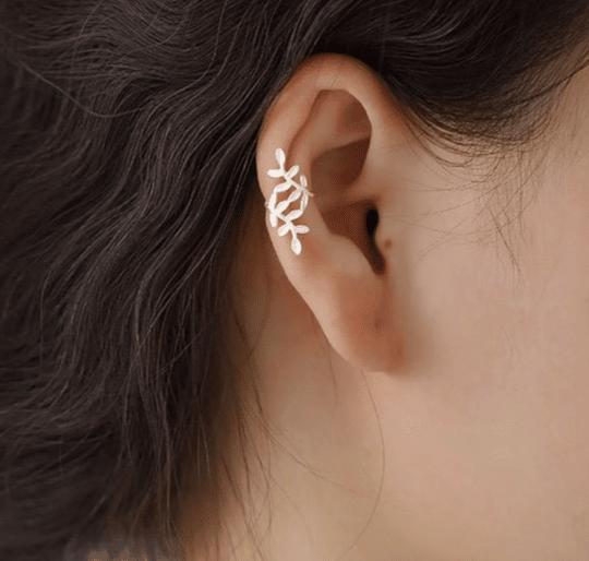 Woman with a silver leaf ear cuff