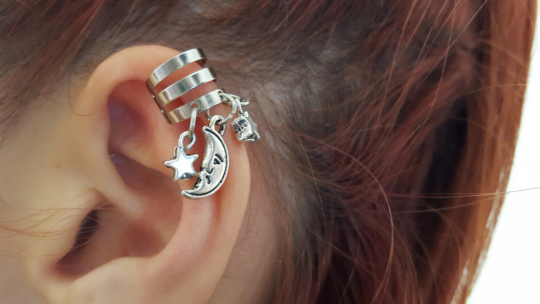 Silver metal ear cuff with moon and star ear tangles