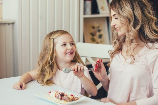 Mom and daughter enjoying some homemade ice cream from their best ice cream maker