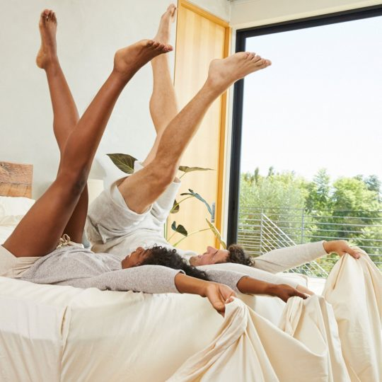 Man and woman enjoying organic superfine suvin sheets