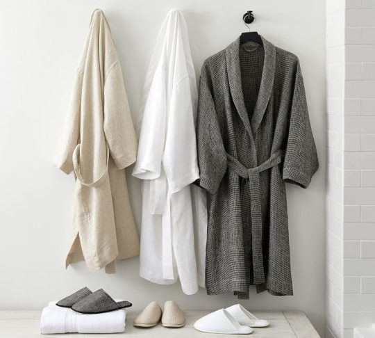 Neutral robes hanging up in a row