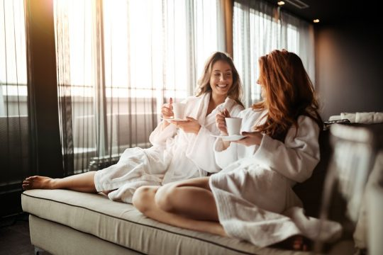 Woman visiting a spa with her friend as a push present