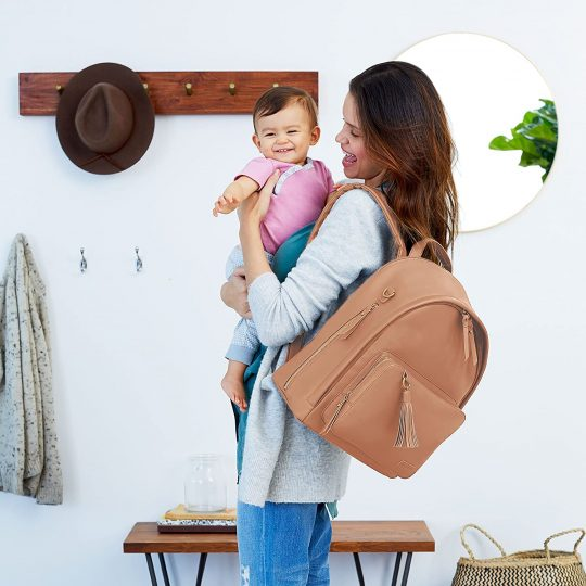 Woman with a brown diaper bag