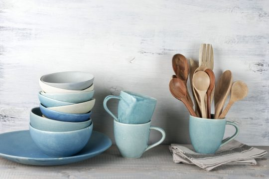 Vintage blue ceramic dishes with wooden spoons