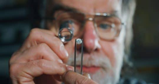 Jeweler inspecting a diamond